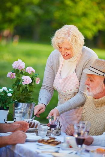 Senior Friends Enjoying At Table