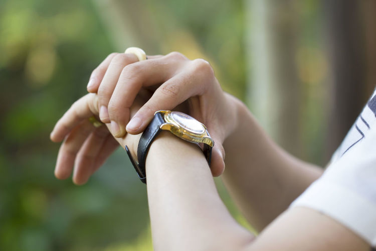 Cropped Image Of Woman Wearing Wristwatch