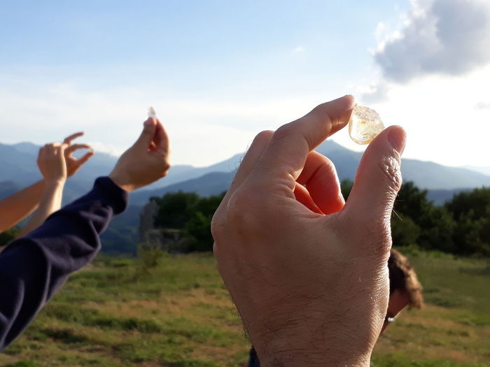 Energy Stones Adult Body Part Close-up Cloud - Sky Esoteric Field Finger Focus On Foreground Hand Human Body Part Human Finger Human Hand Land Leisure Activity Lifestyles Nature Outdoors People Personal Perspective Pietra Di Bismantova Real People Sky