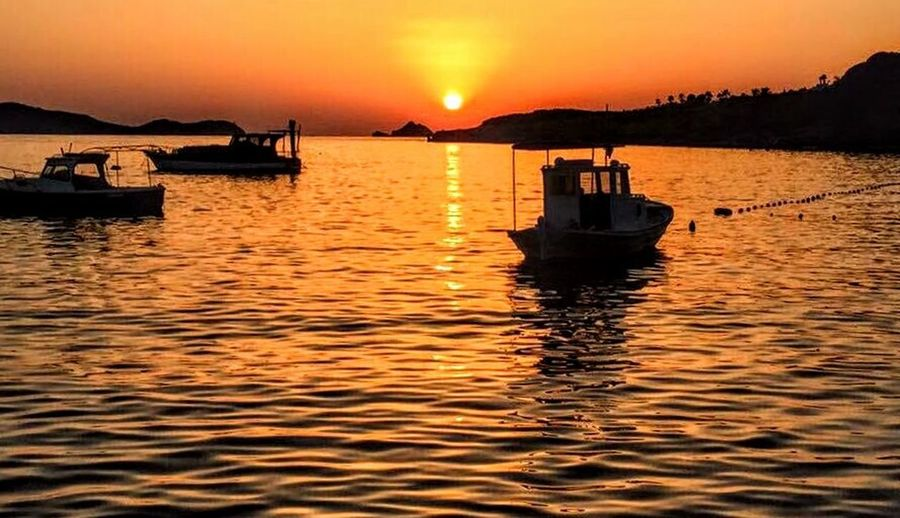 Yalıkavak Transportation Water Nautical Vessel Mode Of Transportation Sunset Sky Sea Reflection Waterfront Beauty In Nature Scenics - Nature Nature Orange Color Sailing Tranquility Travel Tranquil Scene Silhouette Rippled No People