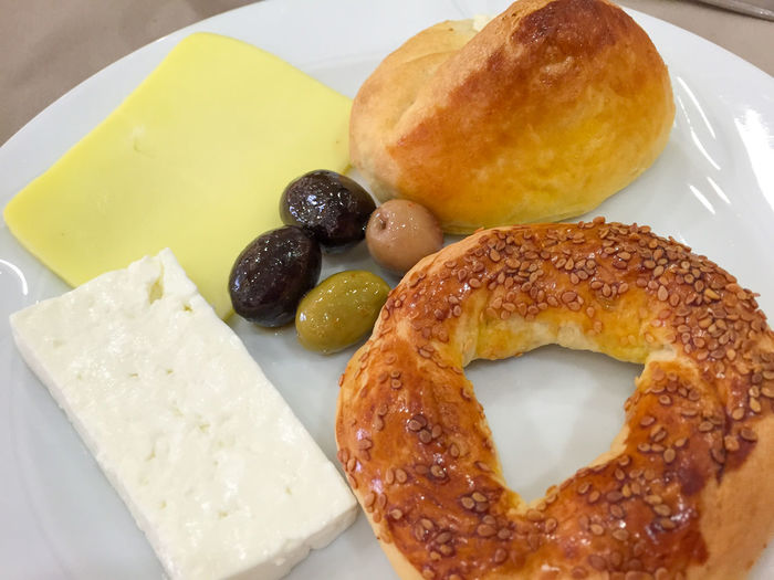 High Angle View Of Bread With Olives And Cheese Served In Plate
