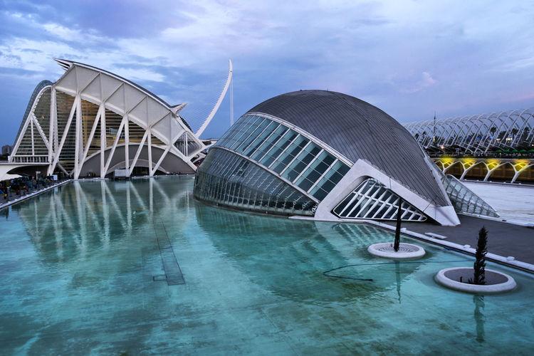 https://open.spotify.com/track/20hX70aeVgiiaGJlMP8Rv4 Architecture Building Exterior Built Structure Ciudad De Las Artes Y Las Ciencias Cloud - Sky Concert Hall  Modern Napatu No People Outdoors Sky Travel Destinations Valencia, Spain Water