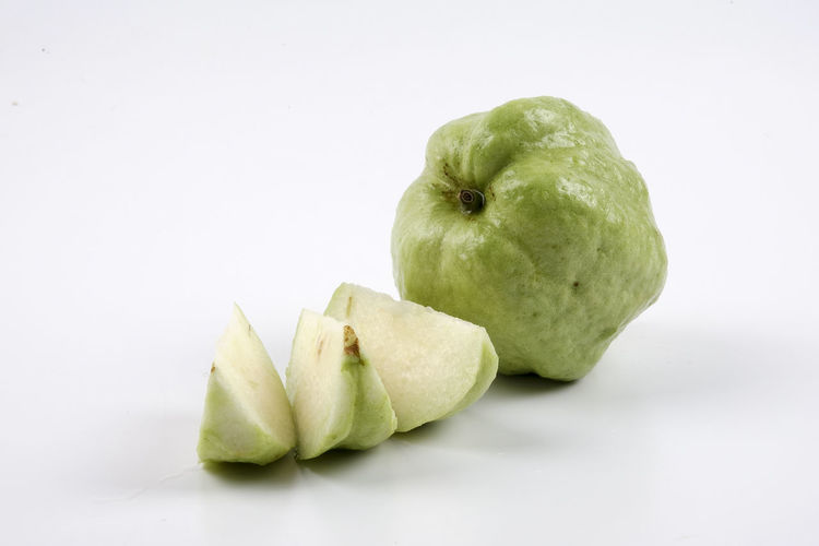 GREEN GUAVA ISOLATED ON WHITE Apple Apple - Fruit Close-up Copy Space Cut Out Food Food And Drink Freshness Fruit Granny Smith Apple Green Color Group Of Objects Healthy Eating Indoors  No People Pear Ripe Snack Still Life Studio Shot Wellbeing White Background