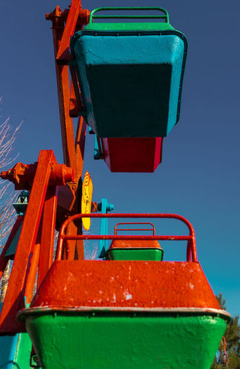 Low angle view of machine against clear blue sky