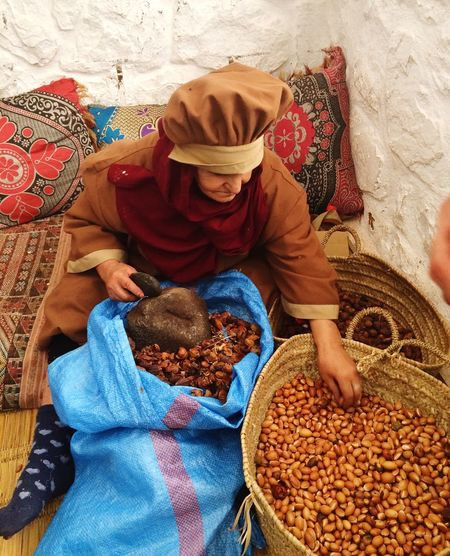 This Berber  Woman is preparing the Argan Nuts to be processed to make ArganOil Marrakech Woman Portrait