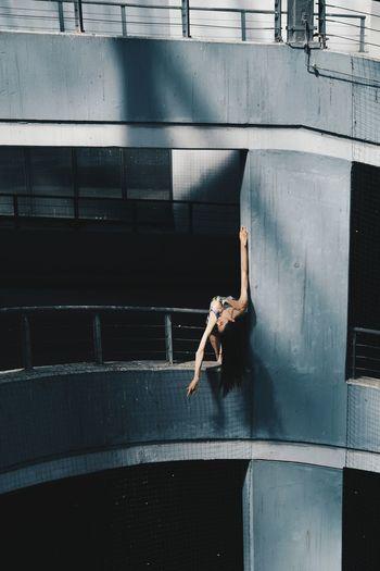Full length of man jumping on railing