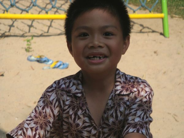 Playing Playground Milk Teeth Milk Tooth Boy Thai Children Thai Kid Black Hair Casual Clothing Portrait Front View Headshot Looking At Camera One Person People Day Confidence  Outdoors Childhood Child Close-up Smiling