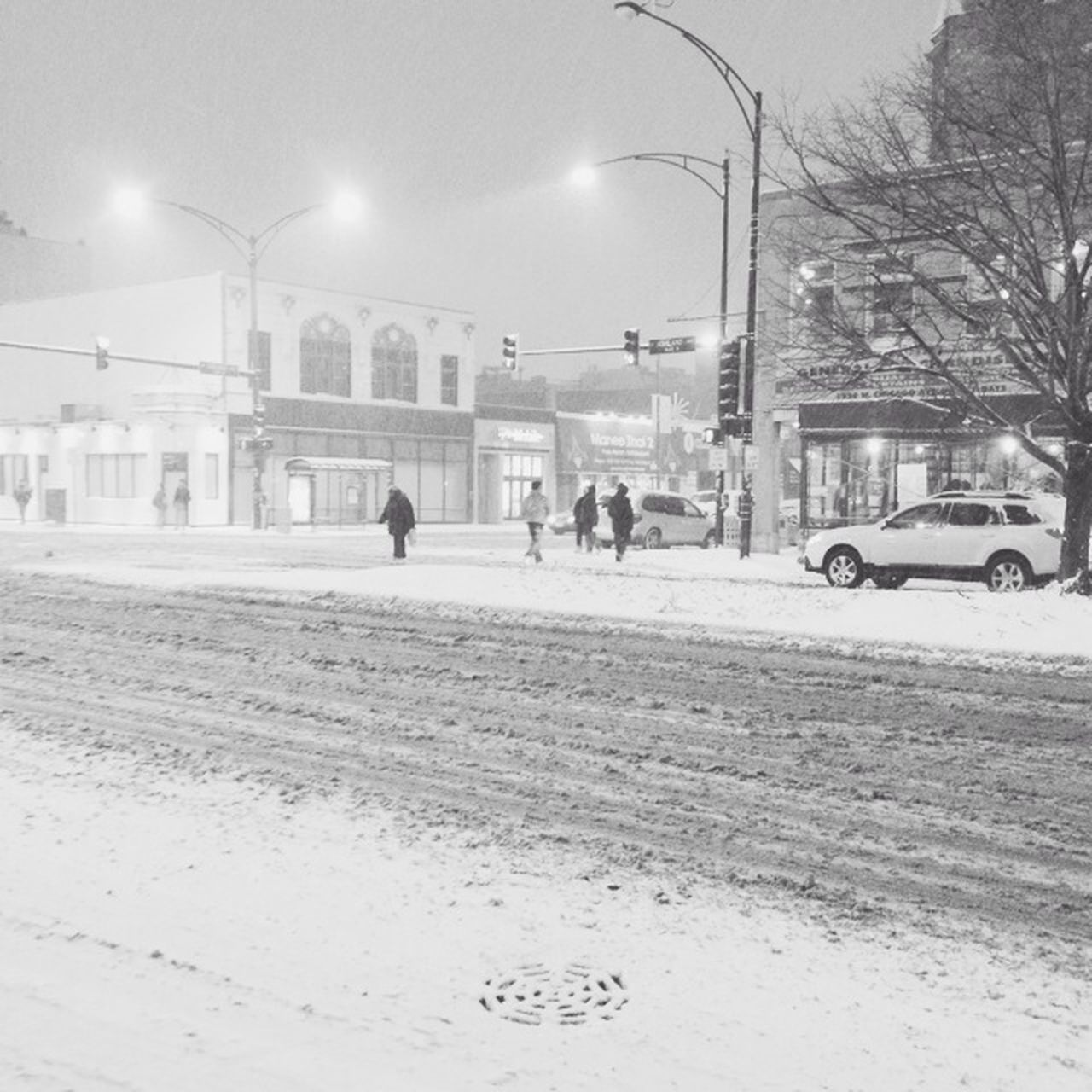 car, real people, built structure, architecture, transportation, building exterior, street, land vehicle, outdoors, street light, snow, winter, road, cold temperature, men, sky, city, day, nature, people