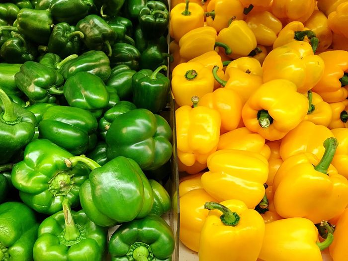 Full frame shot of yellow bell peppers at market stall