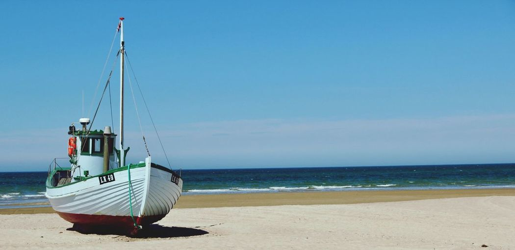 Boat On The Beach Beauty In Nature Blue Sky Water No People Canon600D Fishing Boat The Week On EyeEm