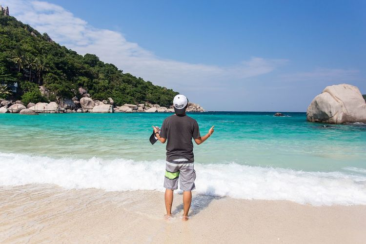 My Favorite Place Beach Water Sea Full Length Rear View Shore Vacations Standing Sand Tree Wave Leisure Activity Horizon Over Water Tranquil Scene Sky Scenics Summer Tranquility Ocean Casual Clothing