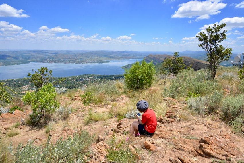 Dreaming on the mountains Harties Hartbeespoort Dam Wall Hartbeespoort Dam Beauty In Nature Nature Real People Nature Sky One Person Day Water Tranquility Plant Sitting Outdoors Scenics Beauty In Nature Full Length Tree People (null)South Africa Mountain Hartebeespoort