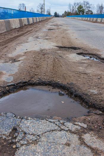 Potholes on the bridge. Bad road. Bad Road Day Hole Mud No People Outdoors Potholes Puddle Road Water