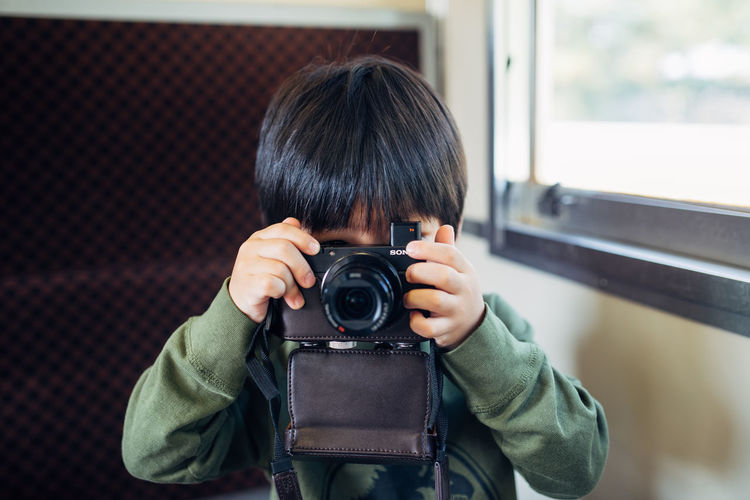 Portrait of boy photographing