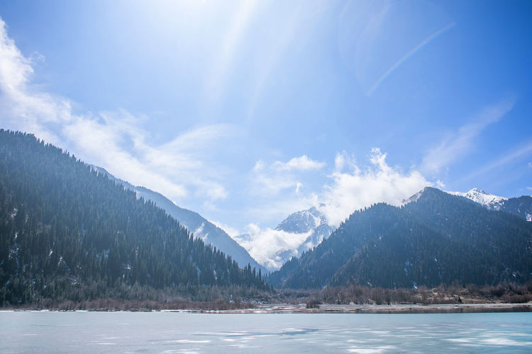 Mountain Sky Cloud - Sky Scenics - Nature Beauty In Nature Tranquil Scene Tranquility Cold Temperature Landscape Nature Winter Snow Environment Mountain Range Non-urban Scene Idyllic Day No People Water Outdoors Snowcapped Mountain Mountain Peak Range