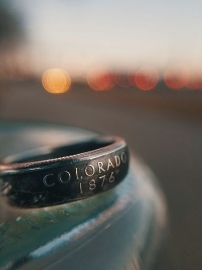 Close-up of text on metal ring