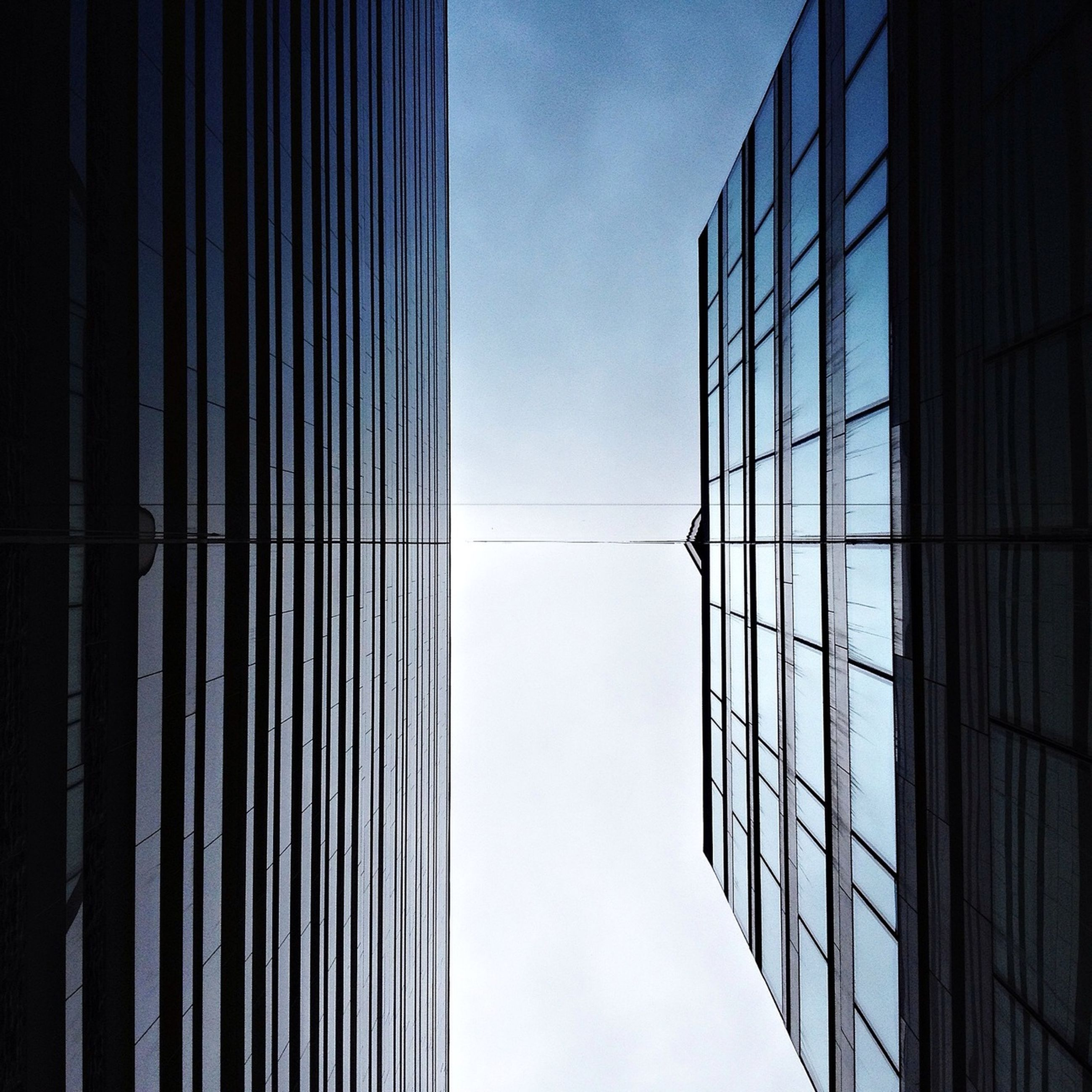 architecture, building exterior, built structure, low angle view, office building, glass - material, window, modern, building, city, reflection, skyscraper, sky, tall - high, tower, day, glass, no people, outdoors, sunlight