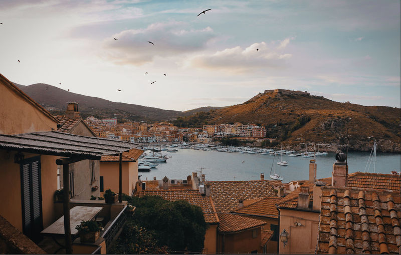Porto Ercole in autumn The Traveler - 2018 EyeEm Awards Architecture Bird Building City Cloud - Sky Flying Mountain Nature Outdoors Sky Town TOWNSCAPE Water