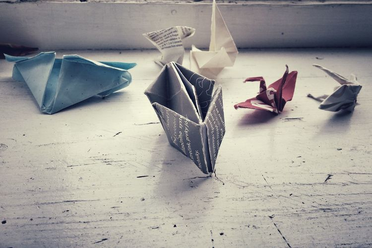 Close-up of origami artwork on table