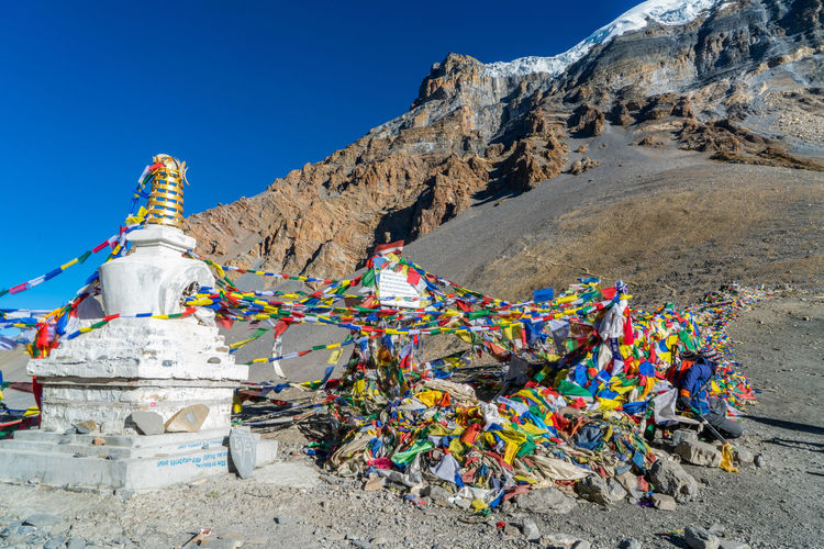 Multi Colored Prayer Flags Against Mountain Range