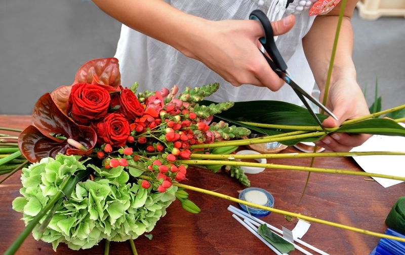 Close-up of woman making bouquet
