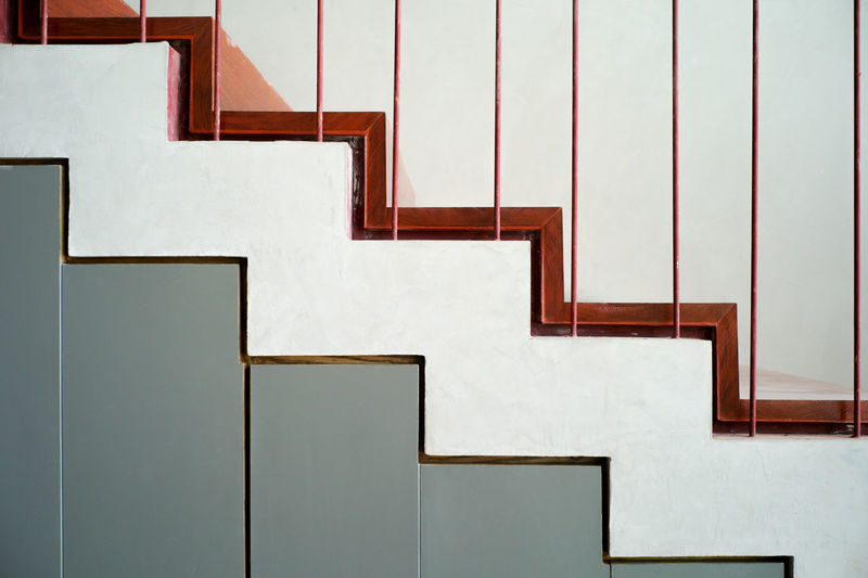 White wall by staircase in building