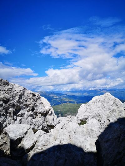 Scenic view of rocky mountains against blue sky