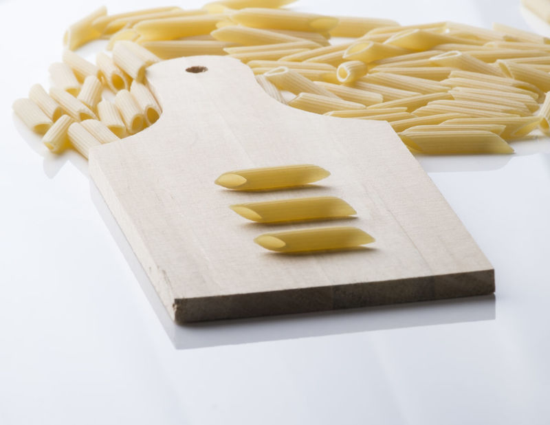 "Format of typical Italian pasta called ""penne rigate"" Italian Pasta Carbohydrates Close-up Cutting Board Diet Food Food Food And Drink Freshness Healthy Eating Indoors  Italian Food Italy No People Pasta Penne Preparation  Ravioli Raw Food Spaghetti White Background"