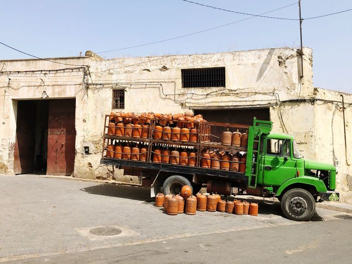 Step on the gas! Green Gas Truck Gas Cylinder Transportation Building Exterior Built Structure Mode Of Transportation Architecture Day Land Vehicle Truck