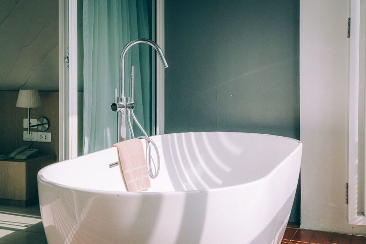 Bathtub against wall in bathroom at home