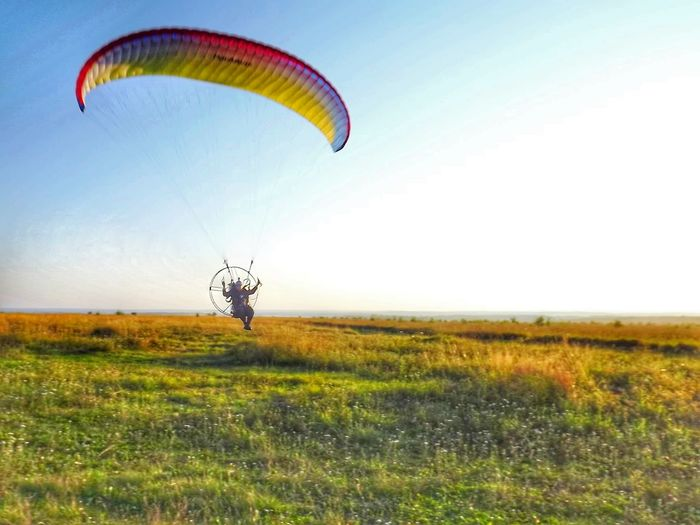 Hot air balloon flying over landscape