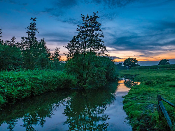Evening at the River Heaven Beauty In Nature Berkel Cloud - Sky Germany Green Color Idyllic Münsterland Nature No People Non-urban Scene Orange Color Outdoors Plant Reflection River Scenics - Nature Sky Sunset Tranquil Scene Tranquility Tree Water
