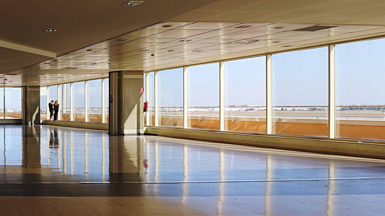 Man And Woman Waiting At Valencia Airport