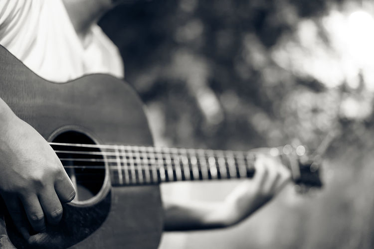 man playing guitar, black&white color tone Black&white Camping Classic Dark Guitar Hand Listen Man Melody Monotone Music Musician Night Party Play Sound Wood