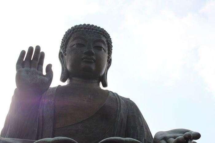 Religion Spirituality Statue Praying Looking Up Human Body Part Place Of Worship Low Angle View Sculpture Idol Adult Outdoors Sky Human Hand Adults Only Day People Travel Photography Tourism HongKong First Eyeem Photo Buddhist Temple Clear Sky No People Tian Tan Buddha (Giant Buddha) 天壇大佛