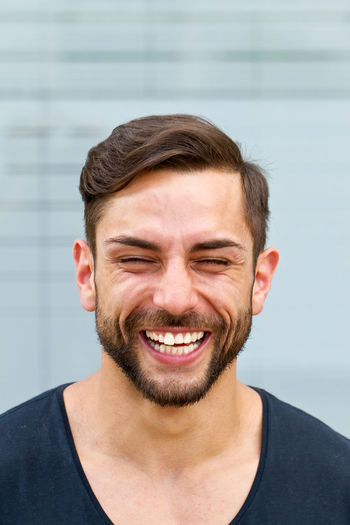 Happy. cheerful man laughing Emotions Fun Funny Happy Humor Joyful Laughing Modern Adult Beard Black Hair Careless Cheerful Eyes Closed  Happiness Headshot Health Joy Men News People Portrait Psychology Smiling Success