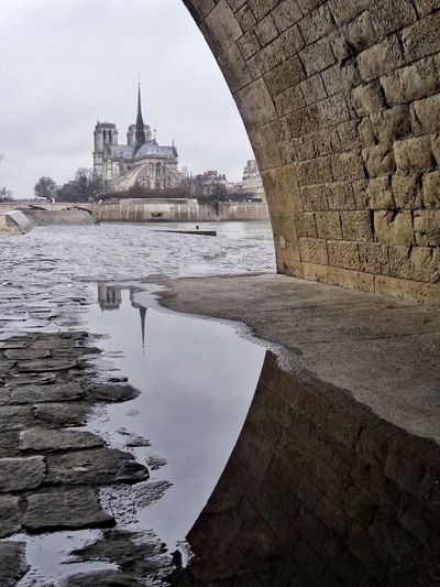 SouslespontsdeParis Notre Dame De Paris Reflection Architecture Built Structure Building Exterior Water Travel Destinations River Travel Tourism Sky Government City Outdoors History Dome No People Bridge - Man Made Structure Nature Day Paris La Seine France Houseboat The Graphic City