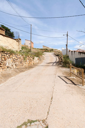 Utrillas Terual Moseo minerio y alrededores. Octubre 2018 2018 October Teruel Utrillas Architecture Built Structure Cable Cloud - Sky Day Diminishing Perspective Direction Dirt Eddl Electricity  Electricity Pylon Empty Empty Road Nature No People Outdoors Power Line  Road Sky Sunlight Telephone Line The Way Forward Transportation