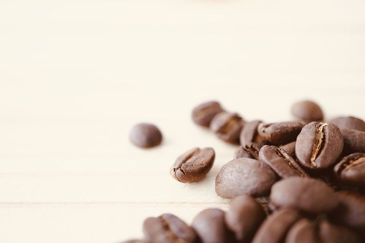roasted coffee bean on light brown wooden texture with copy space, selective focus Copy Space Macro Surface Wooden Light Bean Coffee Freshness Roasted Coffee Bean Table Brown Close-up Food And Drink