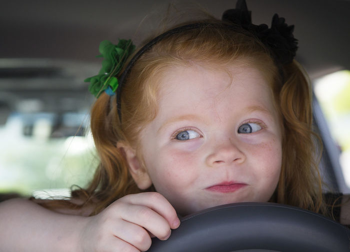 A 3-year-old redhead girl poses for a picture. Blue Eyes Childhood Close-up Cute Day Elementary Age Girls Looking At Camera One Person People Portrait Real People Red Hair Redhead