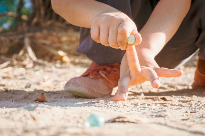 play glass ball Soil Boy Baby Glass Ball Play Land Human Body Part Sand Real People One Person Beach Hand Body Part Human Hand Sunlight Day Lifestyles Outdoors