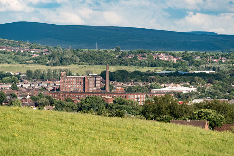 View of Oldham town and surrounding countryside with cotton mill. Hills Industrial Heritage Industry Cotton Mill Factory Landscape Man Made Object Oldham Outdoors Scenics Town