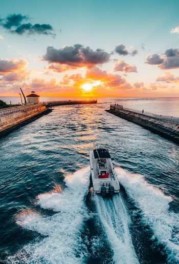 Cruising into the weekend Beach Inlet Inlet Whitecaps Wake Boat Sunset Sea Water Transportation Sky Nautical Vessel Mode Of Transport Cloud - Sky No People Outdoors Scenics Nature Motion Wake - Water Bridge - Man Made Structure Travel Destinations Wave Architecture Beach Crash
