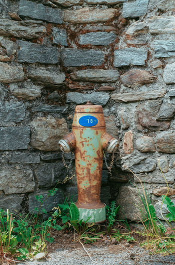 Architecture Botta Fire Extinguisher Mario Botta Mogno Travel Travel Photography Accidents And Disasters Architecture Brick Brick Wall Built Structure Fire Hydrant Metal Nature No People Old Outdoors Plant Protection Security Stone Wall Switzerland Textured  Wall