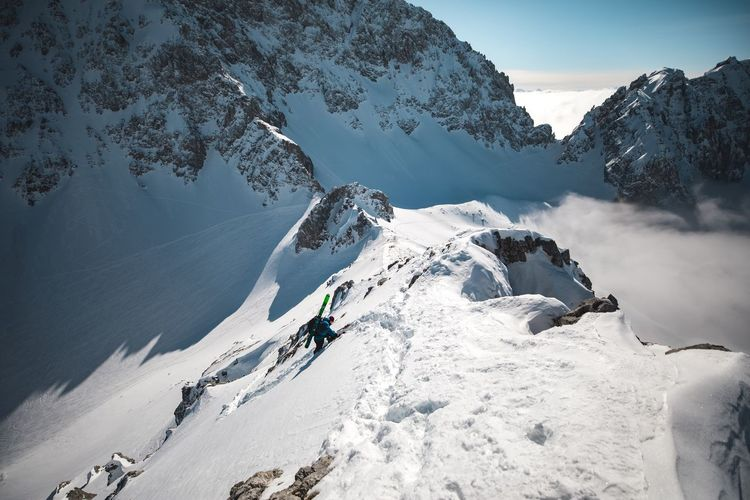 Climbing and skiing 🖖🏻 Alps Snow Climbing Winter Cold Temperature Weather Mountain Nature Beauty In Nature Adventure Sport Landscape Mountain Range Snowcapped Mountain Outdoors Rock - Object Frozen Day Sky