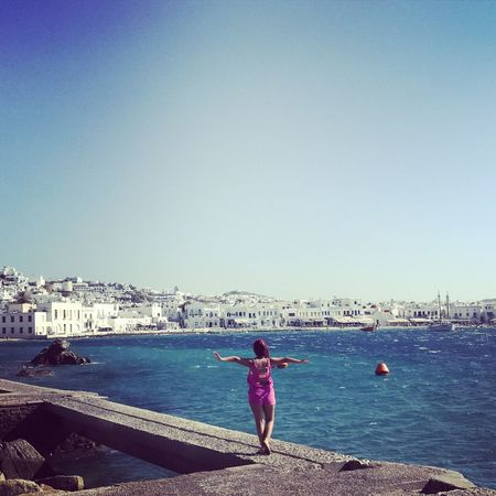 Mykonos,Greece Sea Beach Water Sky Clear Sky Day Full Length Outdoors Only Women Vacations One Person Sand Horizon Over Water Built Structure One Woman Only City Architecture Nautical Vessel Cityscape Adults Only