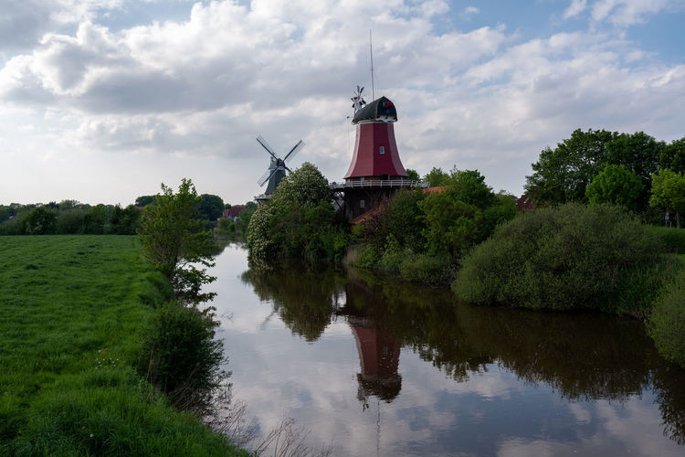 Greetsiel twin mill, Germany. Eastfrisian Greetsiel Greetsiel, Germany Wind Power Windmill Windmills Architecture Beauty In Nature Built Structure Cloud - Sky Day Eastfrisia Environment Germany Green Color Growth Lake Lower Saxony Nature No People Outdoors Plant Reflection Scenics - Nature Sky Smock Mill Tranquility Tree Twin Mill Twin Mills Wadden Sea Water Waterfront