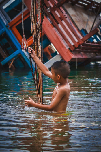 Boys Child Childhood Day Focus On Foreground Innocence Leisure Activity Lifestyles Males  Men Nature One Person Outdoors Real People Shirtless Three Quarter Length Water Waterfront