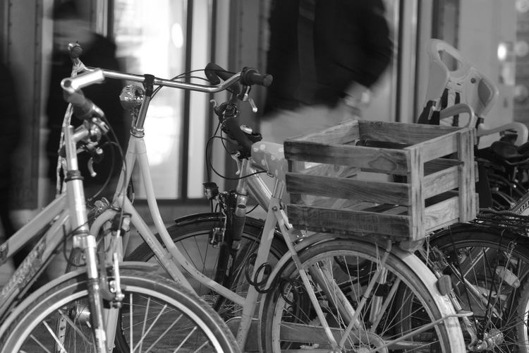 Close-up of bicycles parked in city