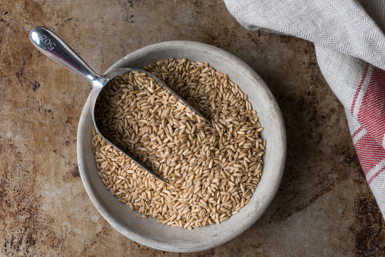 A bowl of oat groats Food And Drink Food Healthy Eating Cereal Plant Oats - Food Bowl Raw Food Directly Above No People Close-up Ingredient Oat Groats Outdoors Groats Scoop Macro Isolated